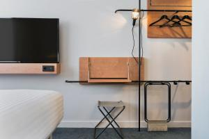 A television and/or entertainment center at Moxy Paris Bastille
