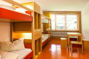 A bunk bed or bunk beds in a room at HI Munich Park Youth Hostel