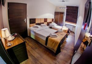 Łóżko lub łóżka w pokoju w obiekcie Boutique Hotel's II