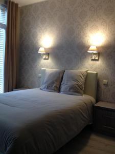 Un ou plusieurs lits dans un hébergement de l'établissement Hotel Chaplin