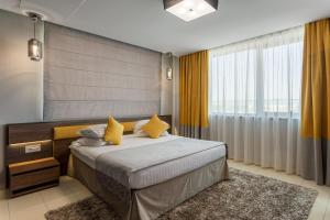 A bed or beds in a room at Splendid Conference & Spa Hotel – Adults Only