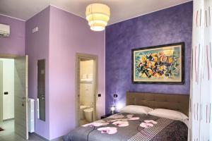A bed or beds in a room at La Collina dei Ciliegi
