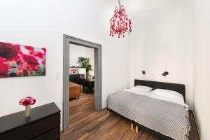 A bed or beds in a room at Karma Boutique Apartments