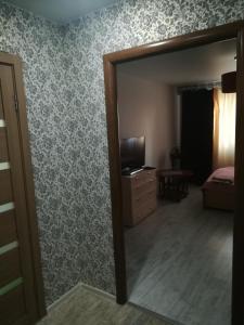 Кровать или кровати в номере Apartments 30 micro-district, 9
