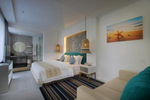A bed or beds in a room at Benoa Sea Suites and Villas