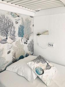 A bed or beds in a room at Camone Apartamento