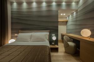 Letto o letti in una camera di MaisonSilvi'