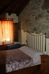 Cama o camas de una habitación en Hotel Rural Santa Cruz