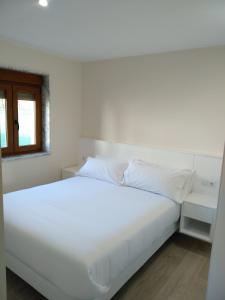 A bed or beds in a room at O CORPIÑO DE CHORENTE