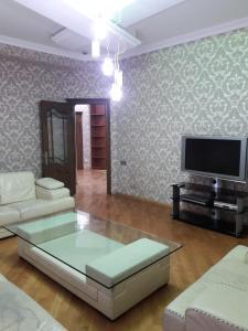 Uma área de estar em HAPPINESS PALACE 2 Bedrooms