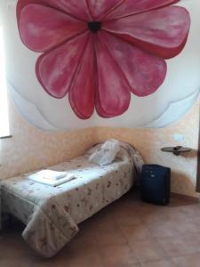 Letto o letti in una camera di Agriturismo Le Caiazzane
