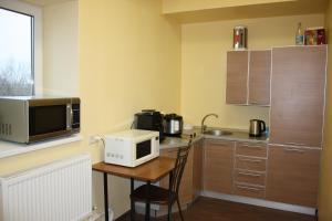 Кухня или мини-кухня в Хостел Москвич