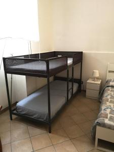 Letto o letti a castello in una camera di B&B Isola Del Sole