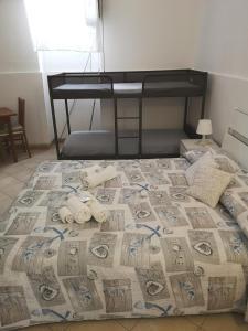 Letto o letti in una camera di B&B Isola Del Sole