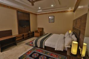 Cama o camas de una habitación en Hotel Norbu House