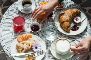 Breakfast options available to guests at Hotel Villa Canu