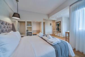 A bed or beds in a room at A.P. Acropolis View Apartments