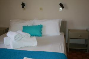 Ένα ή περισσότερα κρεβάτια σε δωμάτιο στο Ξενοδοχείο Αργοστόλι
