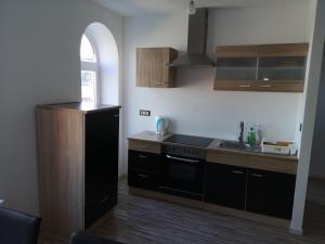 A kitchen or kitchenette at Holsteiner Hof