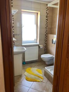 Łazienka w obiekcie Zakątek