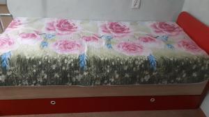 Кровать или кровати в номере Римского-Корсакова
