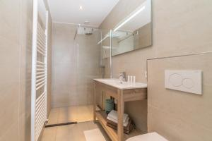 Een badkamer bij Het Vlielandhotel