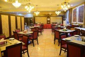 A restaurant or other place to eat at Sharjah International Airport Hotel