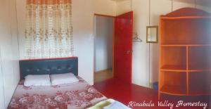 A bed or beds in a room at Kinabalu Valley Guesthouse