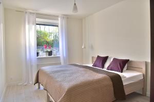 Łóżko lub łóżka w pokoju w obiekcie Apartament Sjesta Park