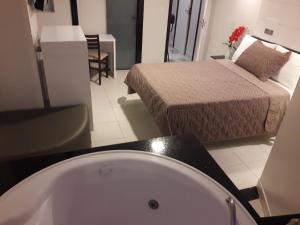 Um banheiro em Hotel Sempre Executive