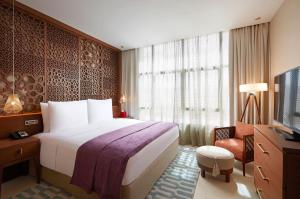 A bed or beds in a room at Shaza Riyadh