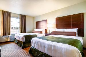 A bed or beds in a room at Cobblestone Inn & Suites-Winterset