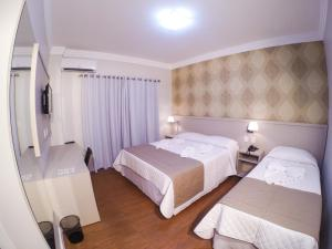 A bed or beds in a room at Seville Park Hotel