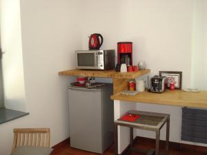 Cuisine ou kitchenette dans l'établissement La Chambre du Meunier