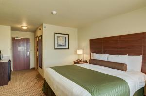 A bed or beds in a room at Cobblestone Inn & Suites-Kersey