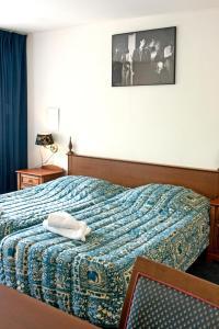 Un ou plusieurs lits dans un hébergement de l'établissement Hotel Prins Hendrik