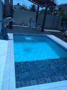 The swimming pool at or near Aconchego Ferreira,só para famílias