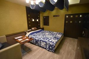 ホテル メリア リゾート(大人専用)にあるベッド