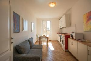 A kitchen or kitchenette at GH Paradiso - Apartments