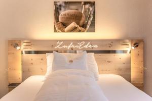 Кровать или кровати в номере Kemmeriboden-Bad Swiss Quality Hotel