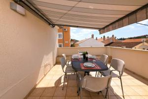 A balcony or terrace at Apartments Bella vista