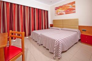 Een bed of bedden in een kamer bij MLL Caribbean Bay