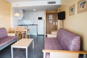 Een zitgedeelte bij Apartamentos Turisticos Terralta