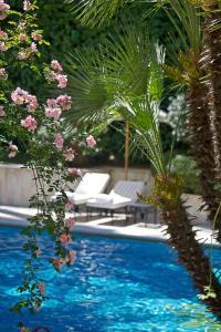 Der Swimmingpool an oder in der Nähe von Aldrovandi Villa Borghese