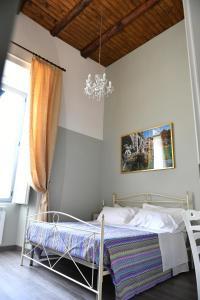 A bed or beds in a room at B&B A due passi