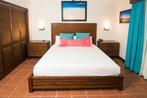 Cama o camas de una habitación en Mayan Princess Beach & Dive Resort