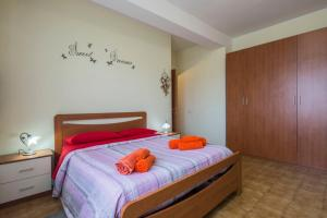 A bed or beds in a room at Il cipresso