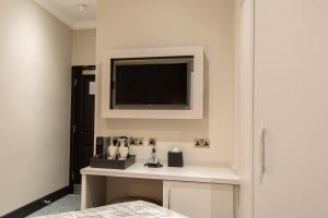 A television and/or entertainment center at The Crescent Hyde Park