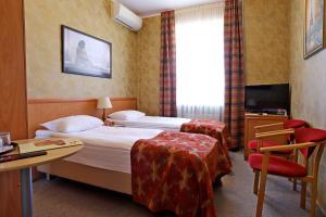 Кровать или кровати в номере Гостиница Моя Глинка