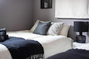 Bijou Suites Rencontreにあるベッド